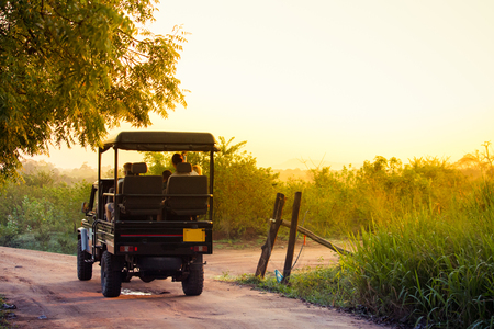 An open topped jeep carries tourists into the national park of Udawalawe, Sri Lanka to search for wildlife in the park.