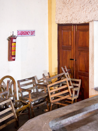 Emergency fire exit of a theather in Kandy, Sri Lanka, blocked by chairs. Stock Photo