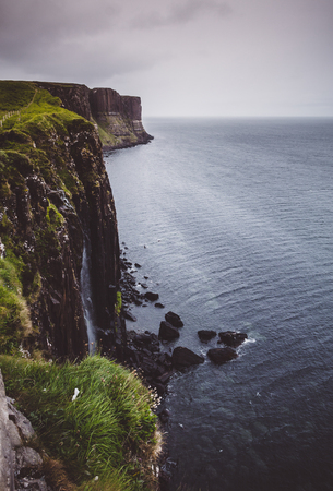 Kilt Rock and Mealt Falls, on the eastern coast of the Isle of Skye, Scotland on a dark, stormy day.