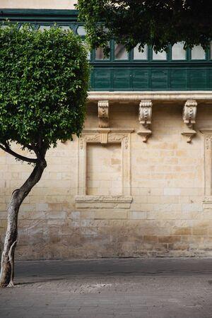 Detail shot of the stonework and balcony in Piazza Regina, Malta