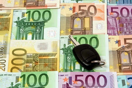 creditors: fferent euro bills are spread out on a table. The money has been prepared for the purchase of automobiles. On top of the money is a car key.