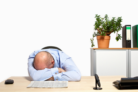 listless: Manager crying at the desk about bad stock prices. The financial crisis has caught up with him. Stock Photo