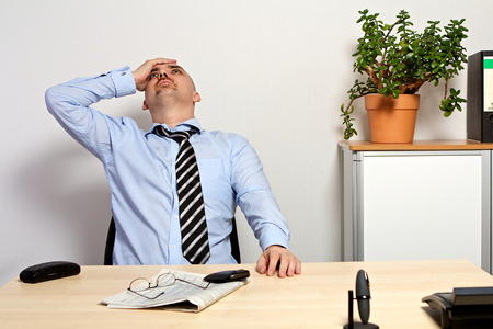 share prices: Manager holds his head because of bad share prices