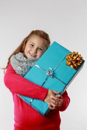 cuddles: Girl cuddles her present, close-up Stock Photo