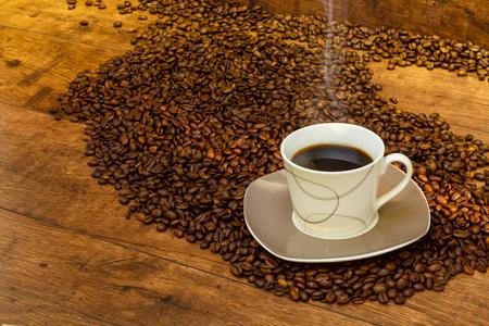 Black, aromatic coffee in the morning sun