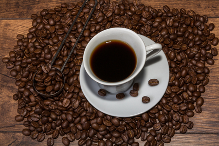 Fresh cup of arabica coffee with aromatic coffee beans