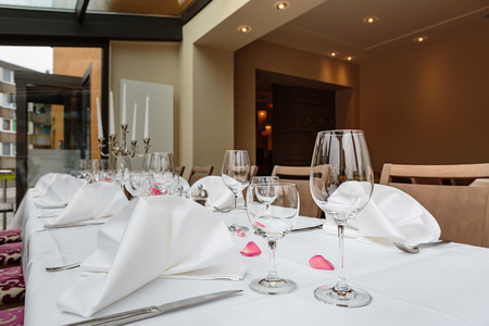Laid tables reserved for diners