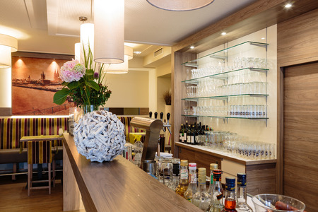 Bar with a nice counter and glass shelves Standard-Bild
