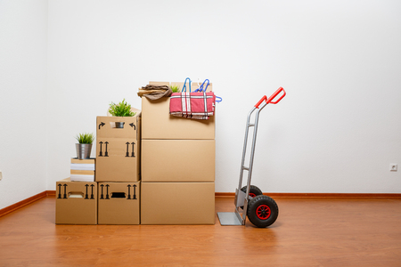 cardboards at the new home with cart  Stock Photo