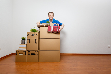 Man lifts moving boxes