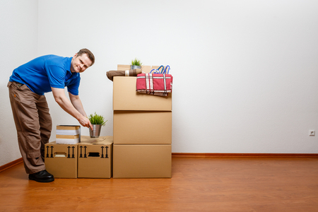 Man unpacking things from moving boxes