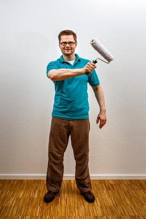 Man paints on imaginary concept wall, vertical format Standard-Bild