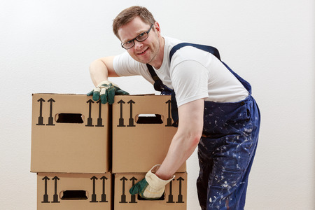 Man lifts heavy boxes