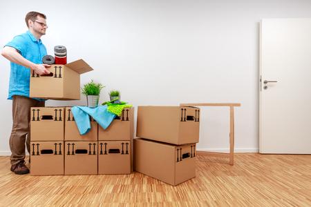 Man picking up moving box