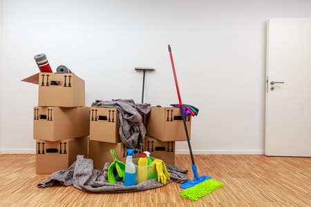 Clean, white room with cartons and cleaning tools Standard-Bild - 122186275