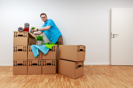 Man empties moving boxes