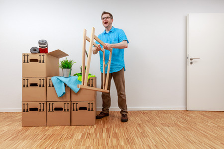 Man fighting with wooden bock Standard-Bild