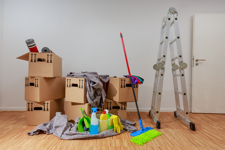 Clean, white room with cartons and cleaning tools Zdjęcie Seryjne