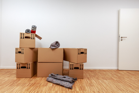 Moving boxes on parquet in new apartment Standard-Bild - 122186977