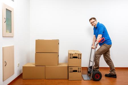 Man is packing cartons on a sack barrow Standard-Bild - 122187206