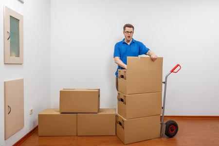 Man is packing cartons on a sack barrow Standard-Bild - 122187351