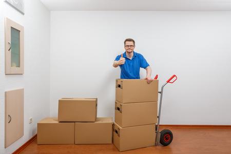 Man is packing cartons on a sack barrow Standard-Bild - 122187368
