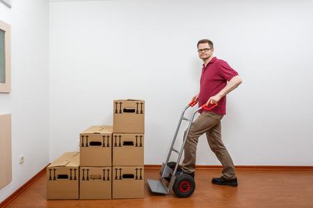 Man pushes a sack barrow