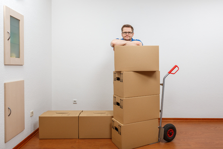 Man stacking boxes on top of each other