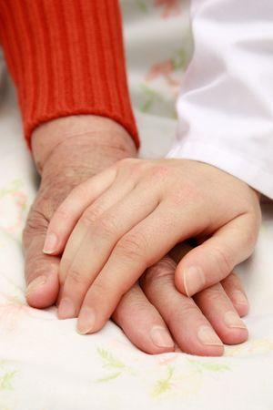 caring hands: Houden handen  Stockfoto