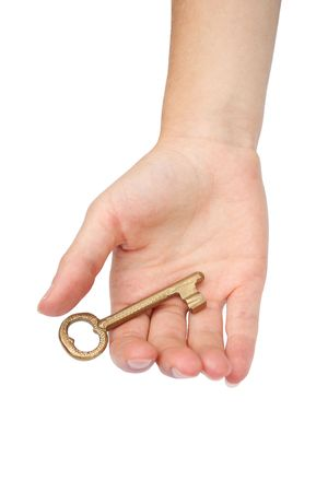 Hand with gold key photo