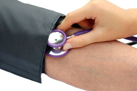 Nurse measuring the blood pressure Stock Photo