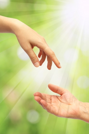 christian faith: Extended hand for help Stock Photo