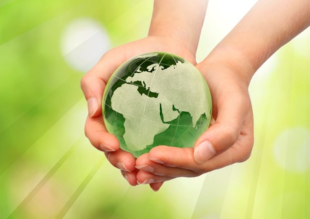 protect earth: Hand holding the Earth