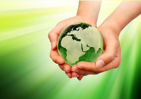 Hand holding the green Earth Stock Photo