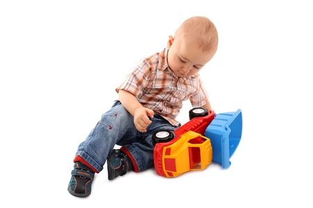 Little boy plays with toy Stock Photo
