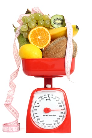 Scale with fruits photo