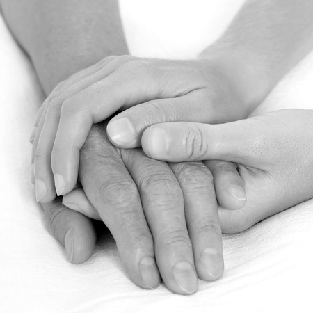 old age care: Holding hand black and white Stock Photo