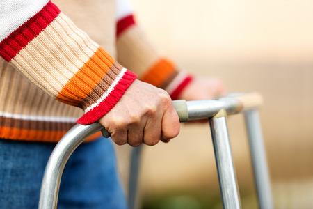 Senior woman using a walker Stockfoto