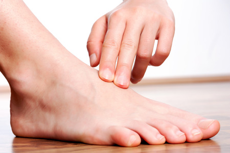 Check your pulse on foot Stock Photo