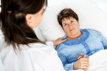 smiling doctor: Doctor and patient Stock Photo