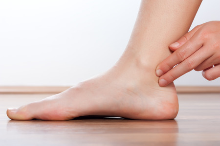 foot doctor: Doctor check pulse on foot