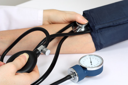 blood pressure gauge: Doctor measuring patient blood pressure