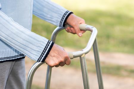 hinder: Senior woman using a walker Stock Photo