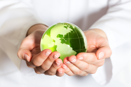 Environmental protection concept with glass globe in hand