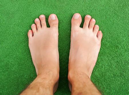 diabetes needles: Foot on green grass