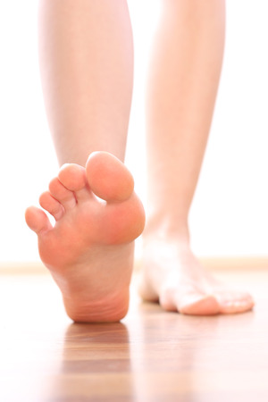 bare woman: Foot stepping legs