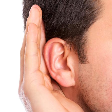 alerta: Mano en el o�do escucha de sonido tranquilo Foto de archivo