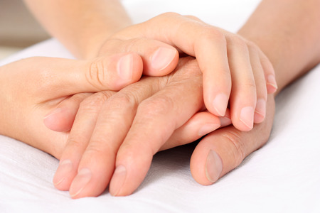 hand in hand: Holding senior hand giving help