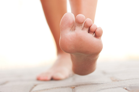 foot pain: Legs walking Stock Photo