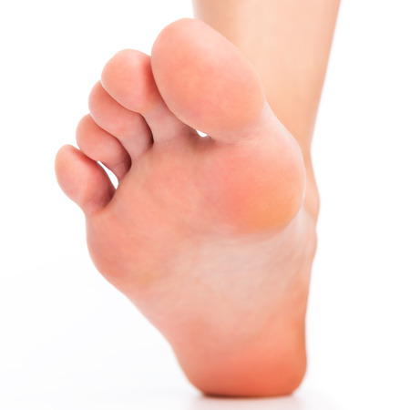 flatfoot: Foot stepping on white Stock Photo